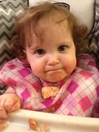 Lily enjoys eating and wearing her pizza.