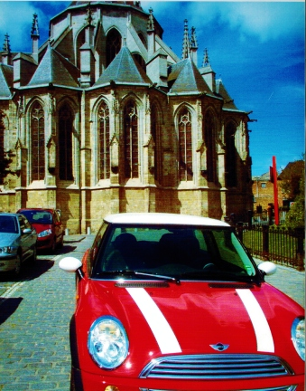 The back of the cathedral and my Mini Cooper