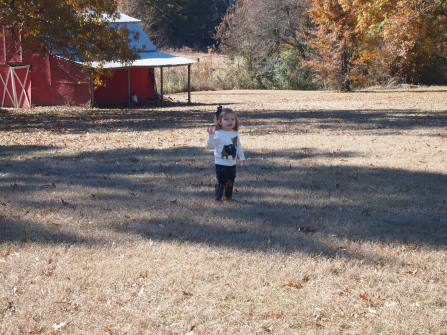 Avery in front of the barn